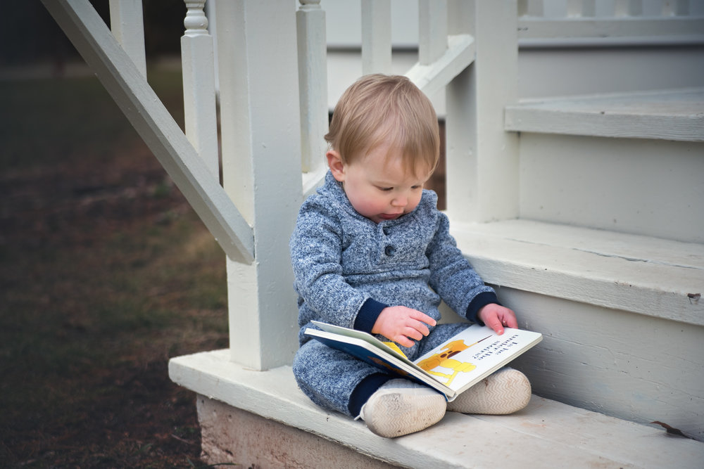 Toddler reading book by Fotoplicity.jpg
