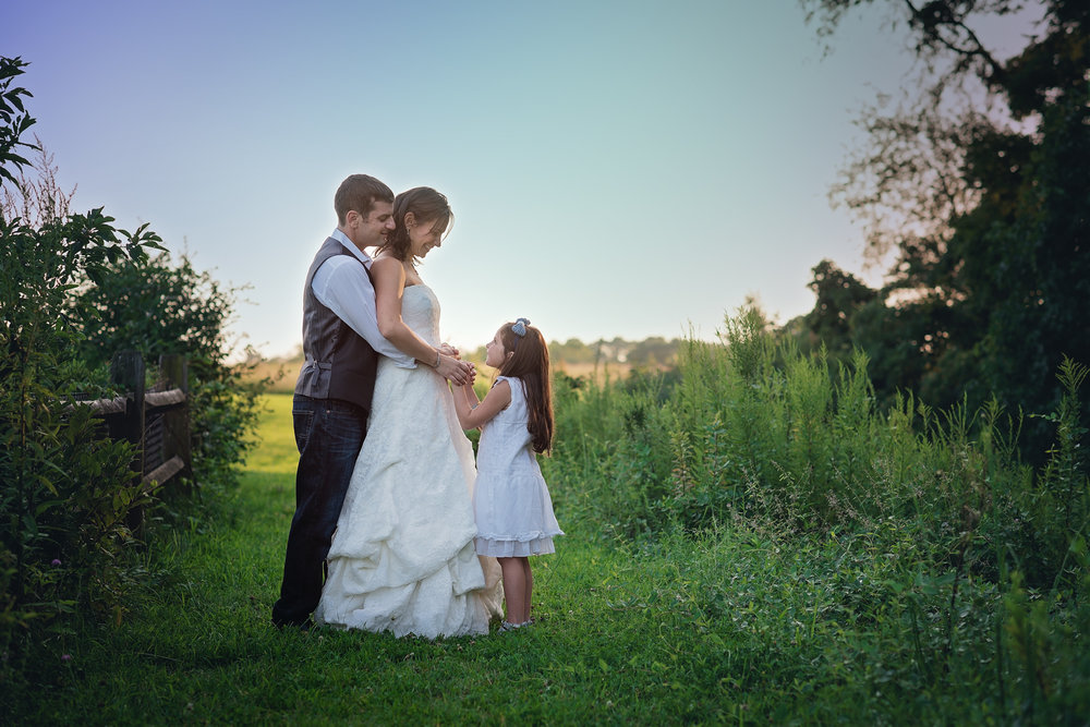 Couple with child - anniversary session