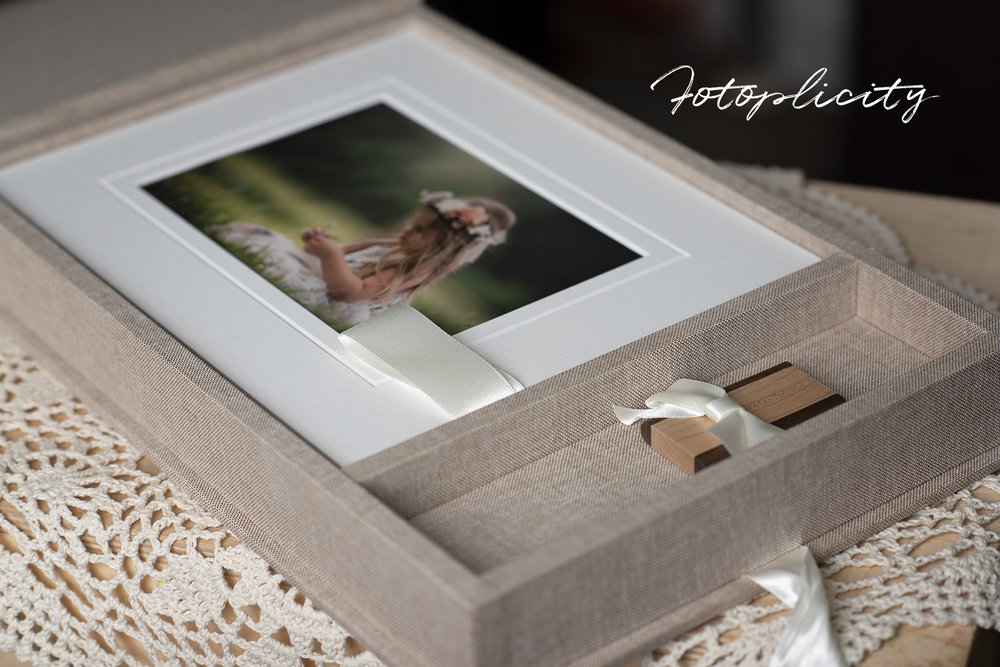 Handcrafted linen memory box with matted fine-art prints.