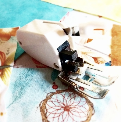 How to use and attach a walking foot - If you are fairly new to quilting, or maybe sewing in general, you will probably wonder what this curious looking sewing machine foot is. It is called a walking foot. A walking foot is a quilter's best friend and many fellow sewers swear by it when sewing garments and bags...
