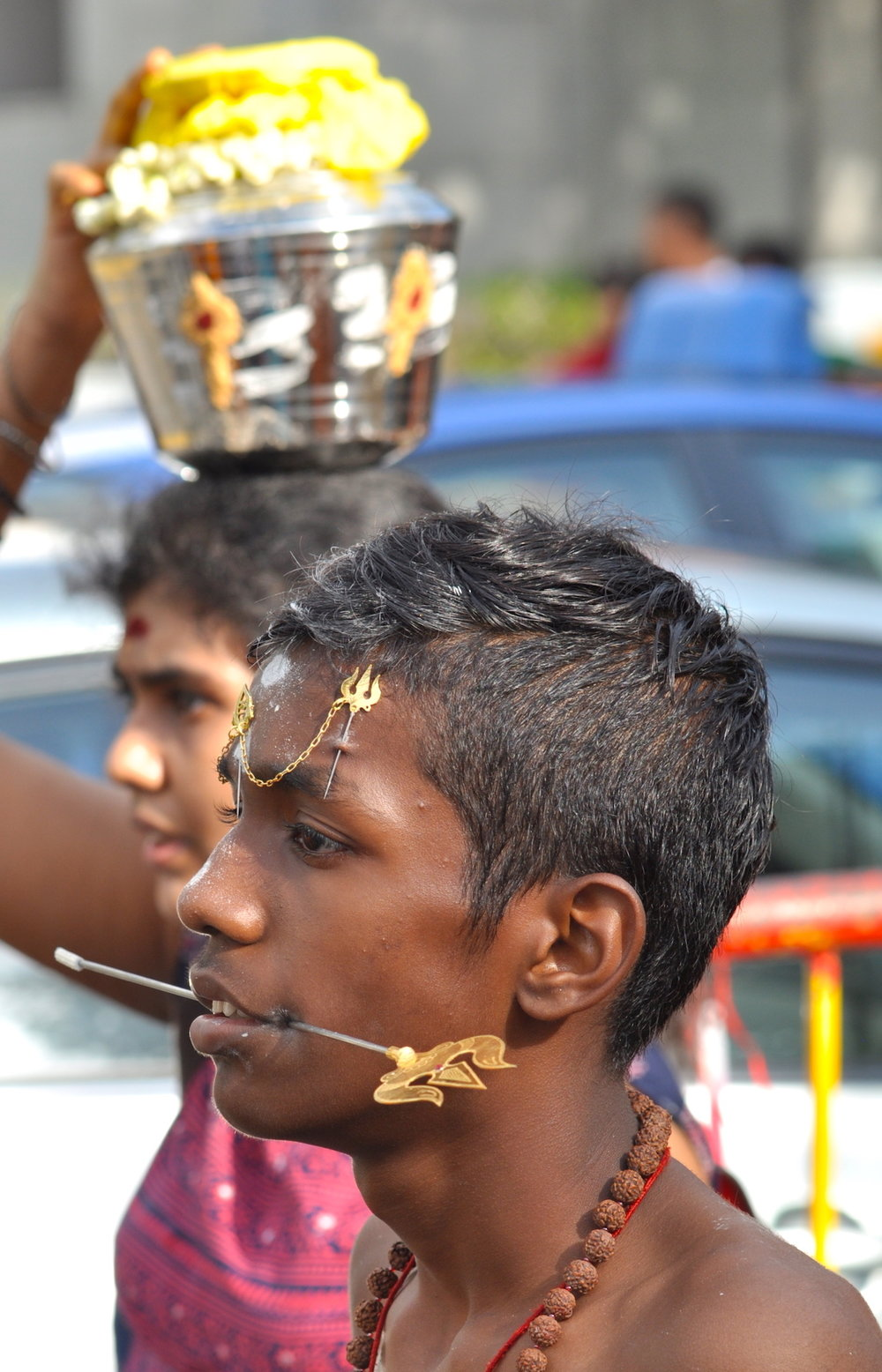 Young man at Serangoon Street during Thaipusam (Singapore). Photo: David Mattatia
