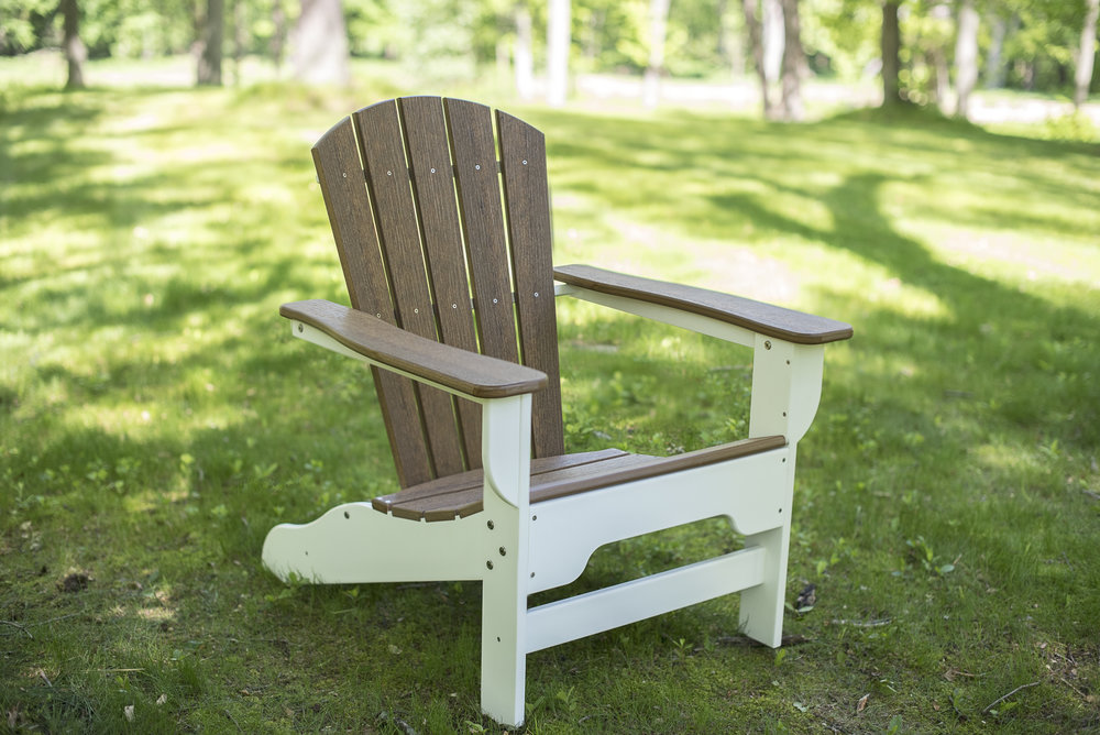 Boca Raton - While it's true you may not live on the beach, you can bring a piece of the coastal lifestyle home with this DuroGreen® Boca Raton Collection Adirondack Chair. Made with the highest quality materials and workmanship, The Boca Raton Collection Adirondack can stand up to weather from any region; so even if you don't live on the beach, your furniture will look like you do.