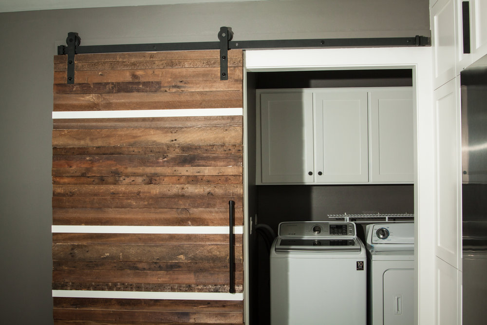 Every home needs a version of this space-saving barn door. I covered this one in gorgeous reclaimed wood.