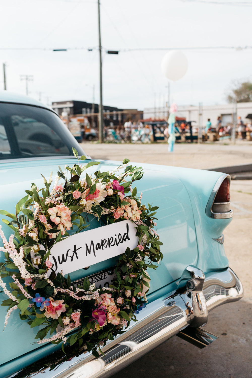 Standard Downtown Knoxville Wedding Venue Central Avenue Happy Holler Blue Car Floral Wreath