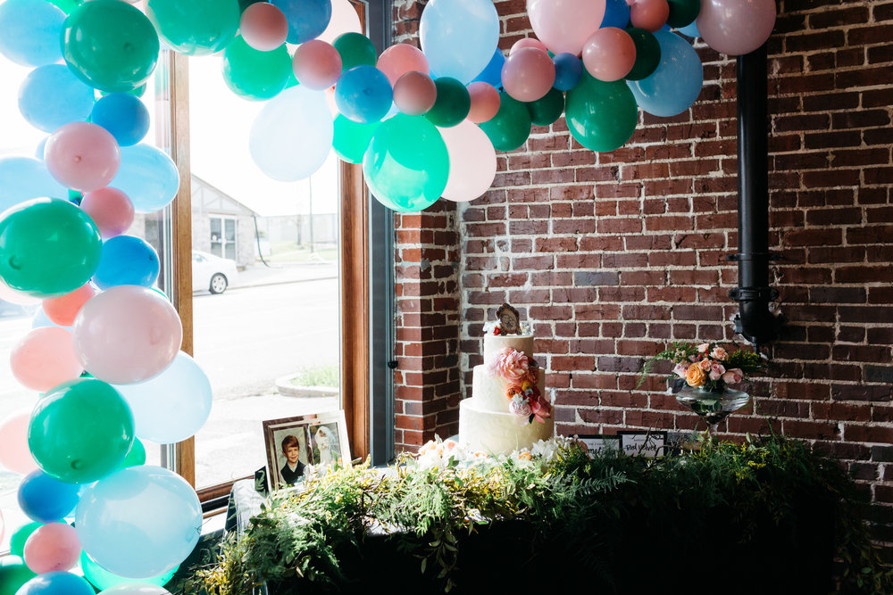 Standard Downtown Knoxville Wedding Venue Central Avenue Happy Holler Exposed Brick Cake Balloons Bouquet
