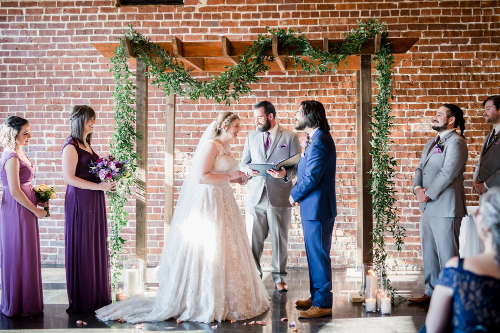 Downtown Knoxville Wedding Venue // Central Avenue Reception // Bridesmaids // Relix Knoxville Floral Design Arbor with Greenery