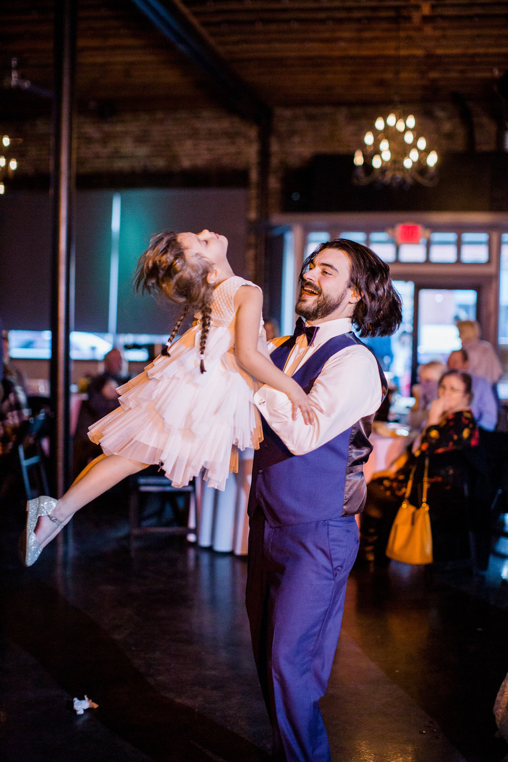 Downtown Knoxville Wedding Venue // Central Avenue Reception // Groom dancing with flower girl