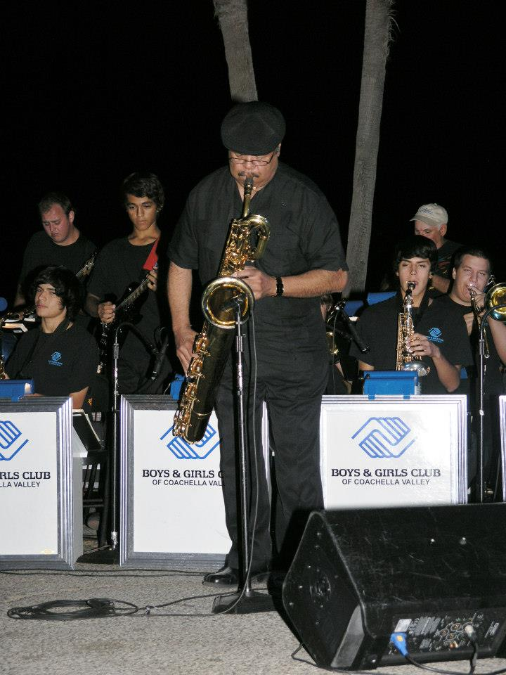 John Bolivar playing with the band.