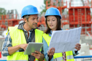 Engineers on building site controlling project