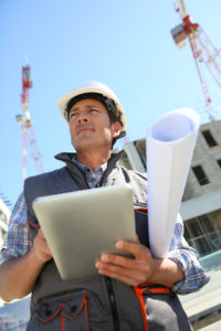 Engineer on building site using tablet