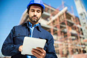 Construction specialist using a tablet computer