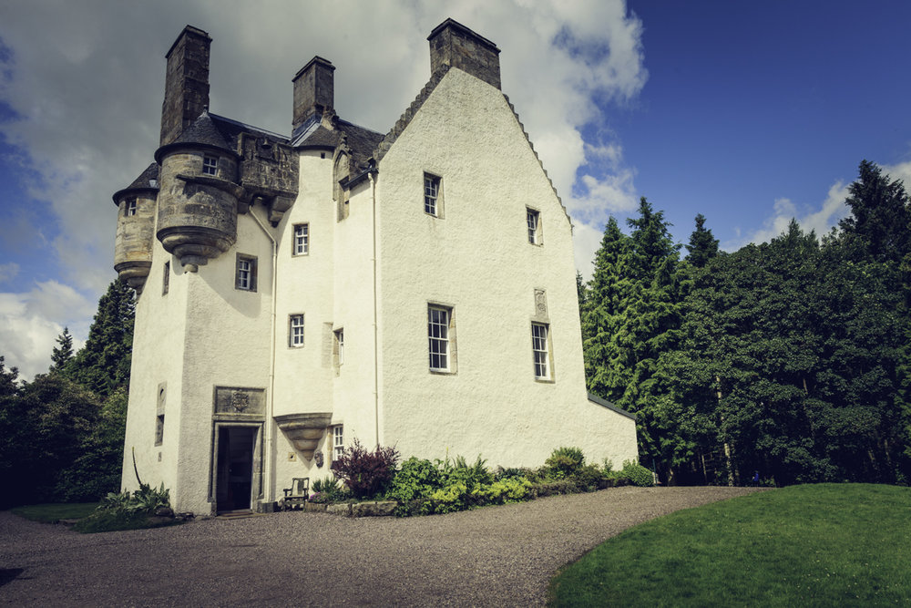 ONCE UPON A TIME... - ....tucked away in the rolling hills of Perthshire, stood a beautiful castle surrounded by enchanted woodlands with a magical maze nestled deep inside.... Tullibole Castle is a 17th Century castle with beautiful grounds, incredible woodland, a moat, a 9th Century Medieval church, a magical maze and is steeped in family history and lots of lots of romantic tales and folklore.Back in the day, a long long time ago, Tullibole's host was knighted by King James for his entertainment alone. Tullibole is exactly half way between Stirling Castle and Falkland Palace so a popular stop for kings of old. Tullibole's entertainment is literally fit got a king!