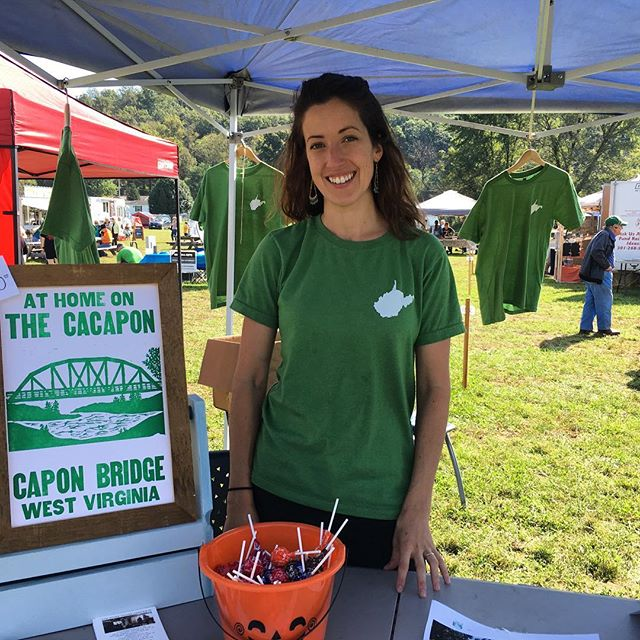 Today you can find us at FOUNDERS DAY! . Stop by our tent to grab a t-shirt, poster or sticker to show your town pride! .  Half of proceeds benefit local charities: Fire Dept., Rescue Squad, Library & The River House . #visitcaponbridge #westvirginia #mywv #gotowv