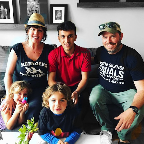 Juli, Bashir, her husband, and their family in their San Franciscan home