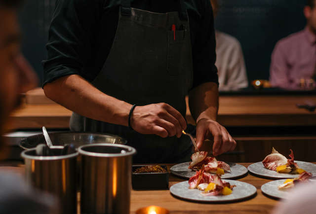 Thrillist | The Best Restaurants in Denver Right Now - Part of a dual concept that includes daytime favorite Call, moody Beckon offers a dining experience like no other in town.