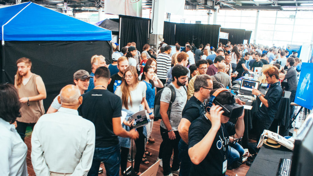 A large crowd of World Fair Nano attendees behind Oblix's booth.