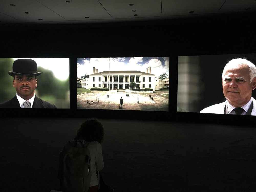 "John Akomfrah , ""Precarity,"" 3-channel video at the Ogden Museum of Art."