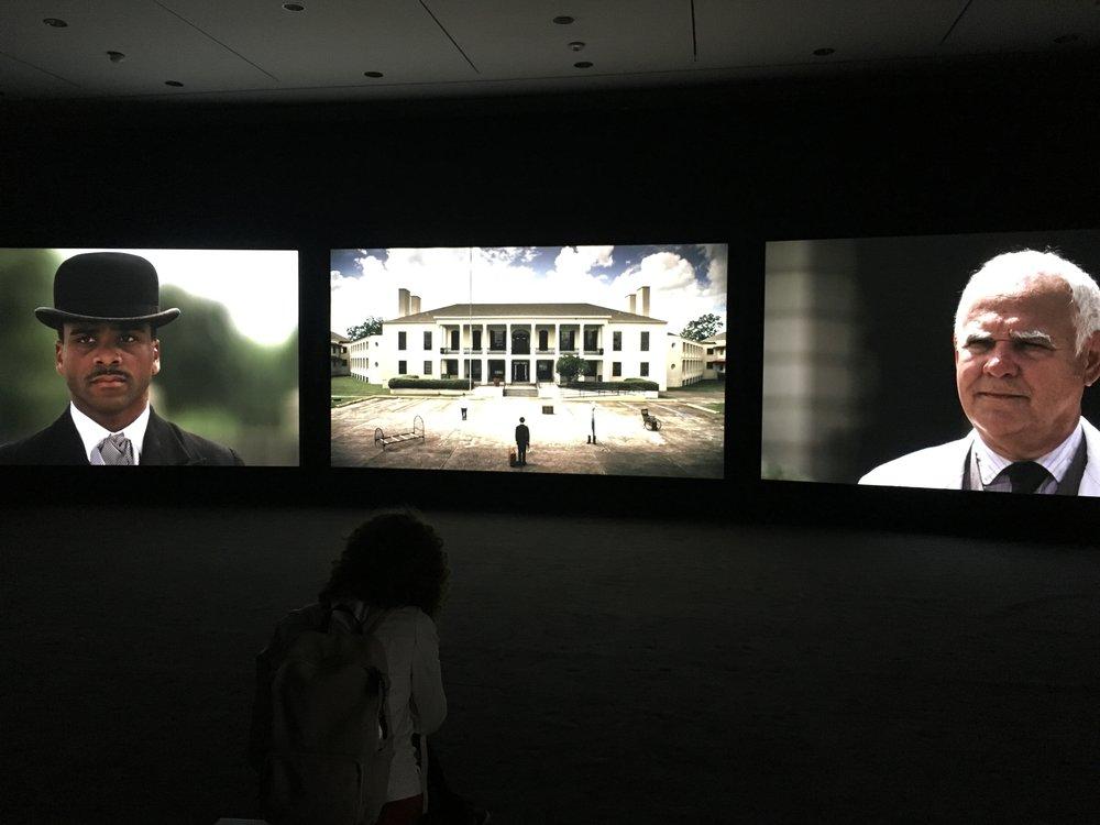 "John Akomfrah , ""Precarity,"" 3-channel video at the Ogden Museum of Art."