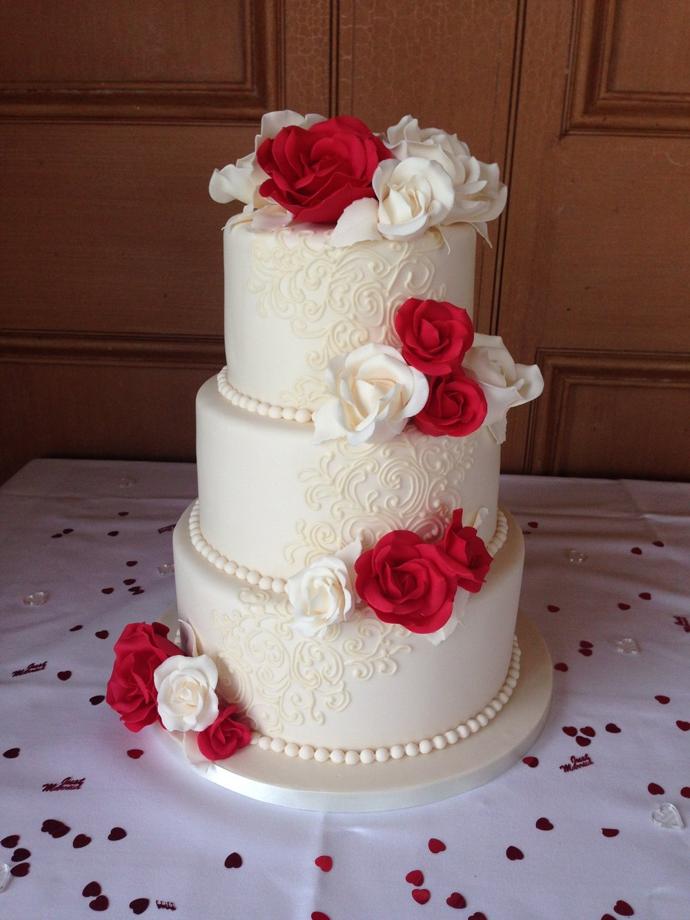ivory and red wedding cake. Loren Brand Cakes
