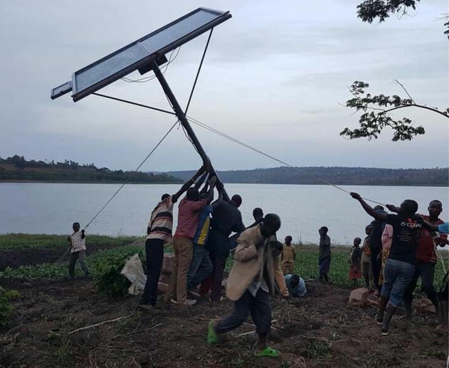 Lead by IDEAS Fellow John Bosco Gakumba, a group of farmers raise a small scale solar panel system to irrigate crops for the entire village   in times of drought. (Rwanda, 2018)
