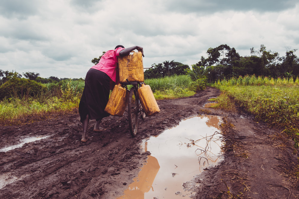 A women traveling after collecting water in Kamuli, Uganda