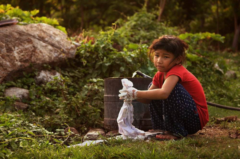 A young girl washing clothes in Chepang, Nepal