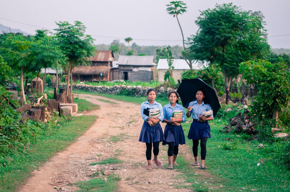 Young girls walking from school in Chepang, Nepal