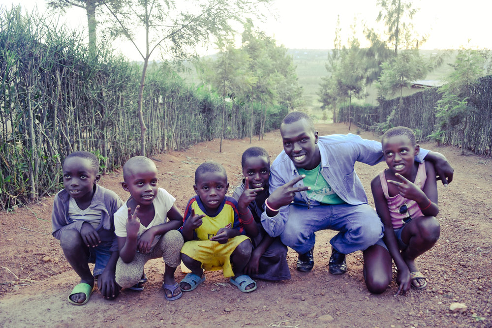 Kids and our Hive Leader Kenneth in Nyanza, Rwanda