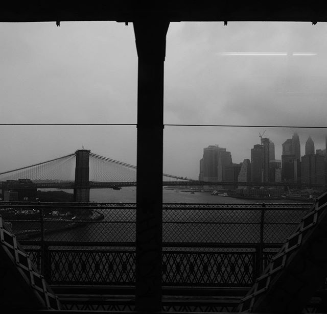 I never tire of the view from the Q and B trains crossing the Manhattan Bridge. When I tire of this gloomy weather I think about the Carolinas and hope everyone there is safe. . . . #newyork #manhattanbridge #bridgesofinstagram #brooklynbridge #newyorkcity #bnw_demand #ig_cityscapes #fujifilm #skyline