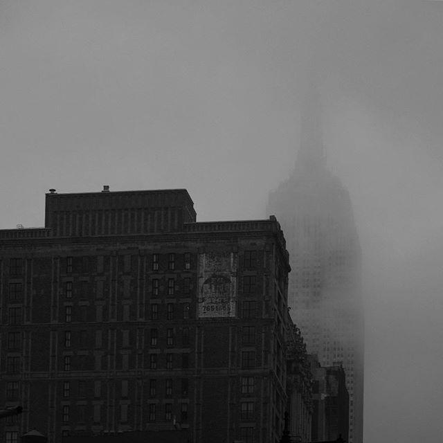 Empire State Building. Rain, fog and low cloud cover. . . #newyorkcity #empirestatebuilding #bnw_captures #fujifilm