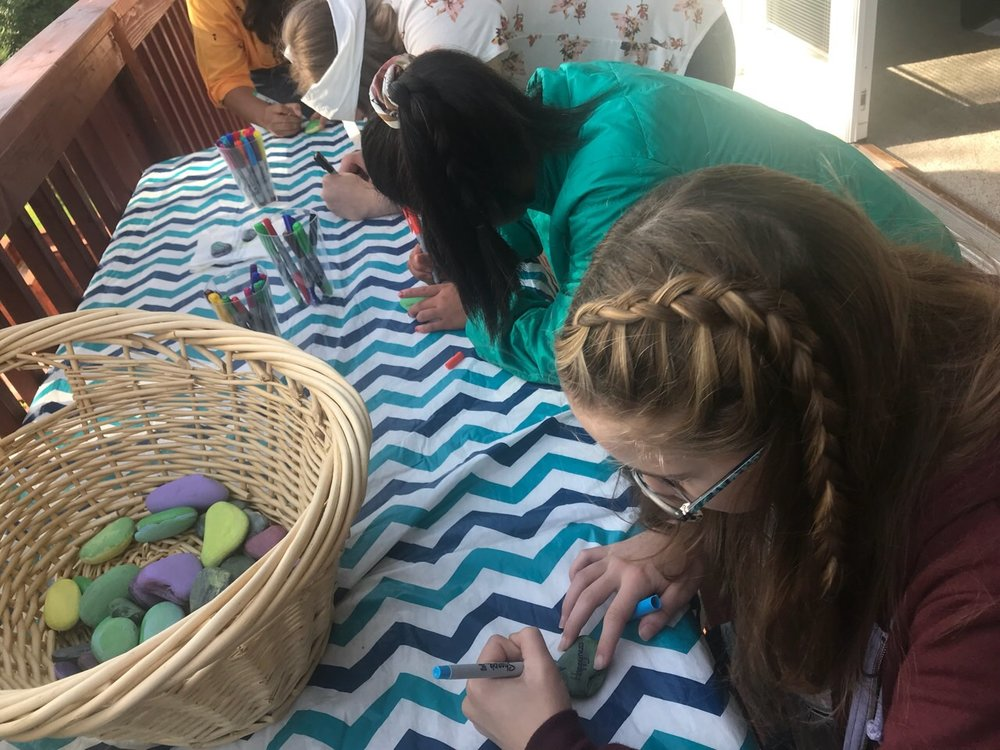 We also host Girl's and Guy's activities to encourage and empower our teenagers. Here, we painted rocks and wrote words on them that we thought described ourselves. At this event, we had the girls also write letters their future selves, with goals and aspirations for the current school year.