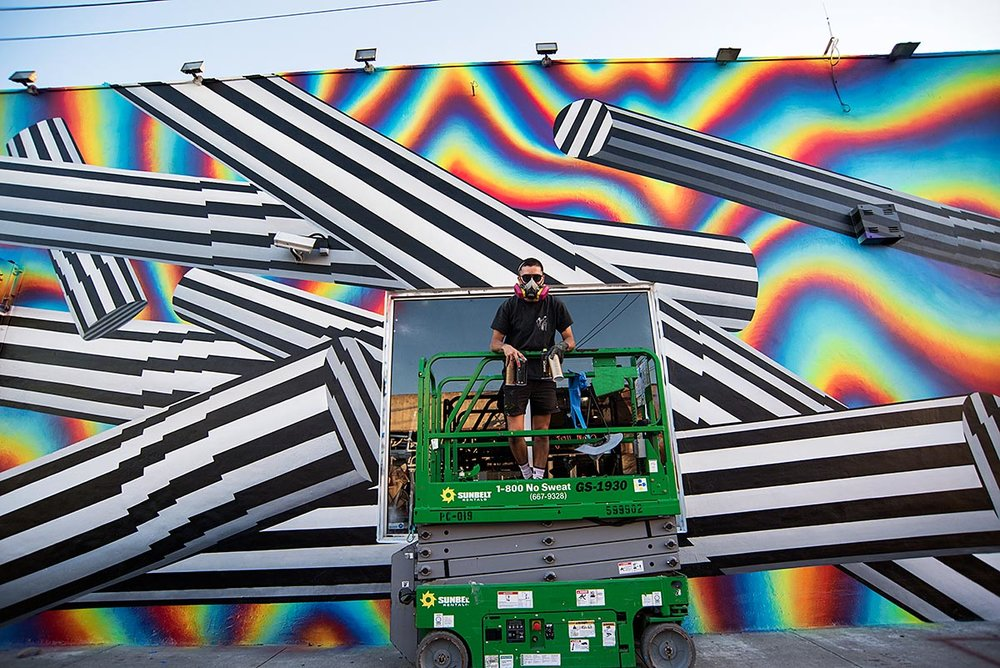 FELIPE PANTONE AT WORK ON HIS WYNWOOD MURAL