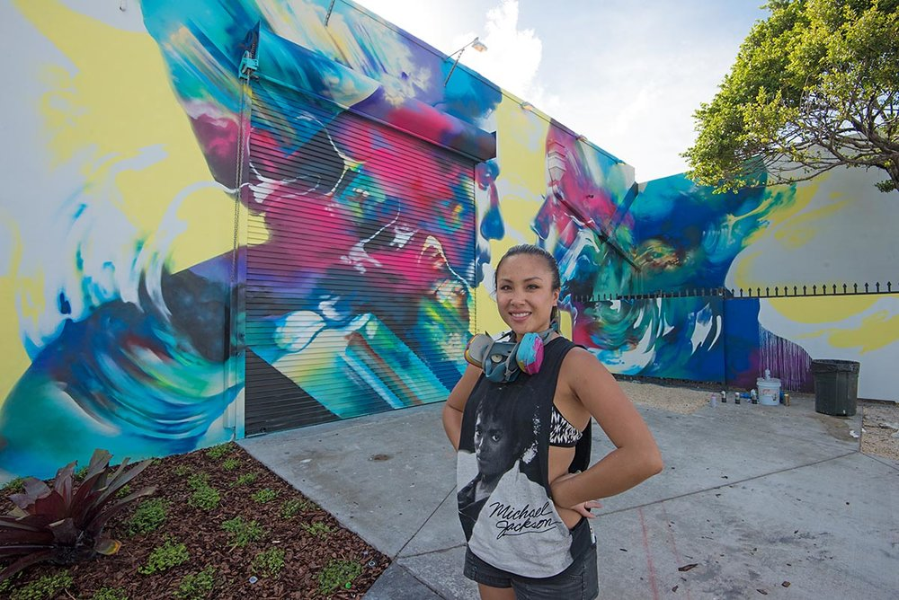 HUEMAN IN FRONT OF HER MURAL INSIDE THE WYNWOOD WALLS