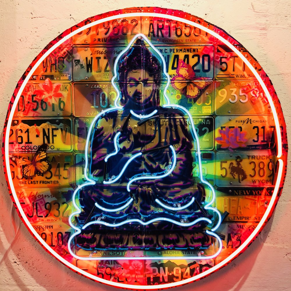 RISK  Round Buddha , 2017  Aerosol, kandy car paint and crushed abalone on license plate panel with surf board resin and neon  48 in. round