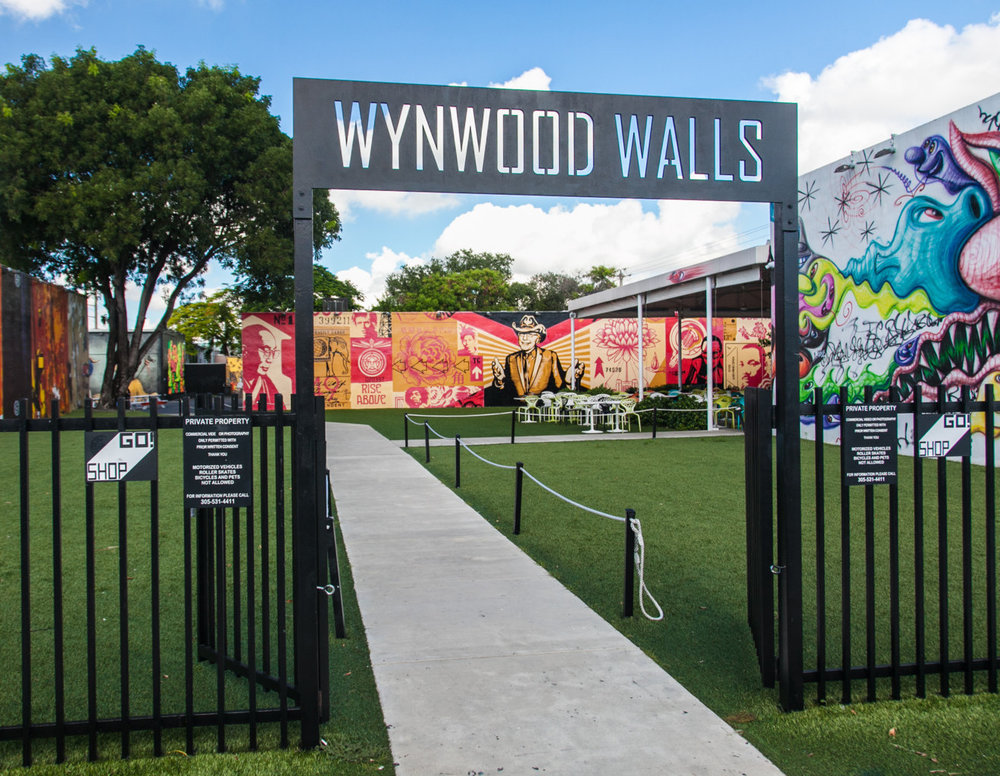 HISTORY OF THE WYNWOOD WALLS - In the early 2000's, Wynwood was much like any other industrial urban neighborhood that had fallen on hard times. It had its share of failed manufacturing businesses, abandoned warehouses, and crime. Pedestrian activity was non-existent. Joey Goldman was tasked with finding the next zone for the Goldman Family; he discovered Wynwood.Enter Tony Goldman, founder of Goldman Properties. Rather than work to erase what others considered blight, Tony envisioned a town center that highlighted what made Wynwood authentic and provided a place for people of all walks of life, from all over the world, to congregate, explore, and be inspired. In 2009, the Wynwood Walls was born. Today, the exterior walls serve as giant canvases for the greatest street art collection ever assembled in one place.In eight years, The Wynwood Walls has helped ignite one of the largest art movements in history, elevating street art to a genre that is widely respected by art lovers of all economic classes and changing the paradigm of how people interact with art. Thought-provoking and celebratory of creativity and talent, The Wynwood Walls have become a focal point of what is happening in the world of street art. Since its inception, The Wynwood Walls has been a platform for more than 90 artists, representing 20 countries, and covering over 85,000 square feet of walls.- JESSICA GOLDMAN SREBNICKCEO Goldman Properties & Goldman Global Arts