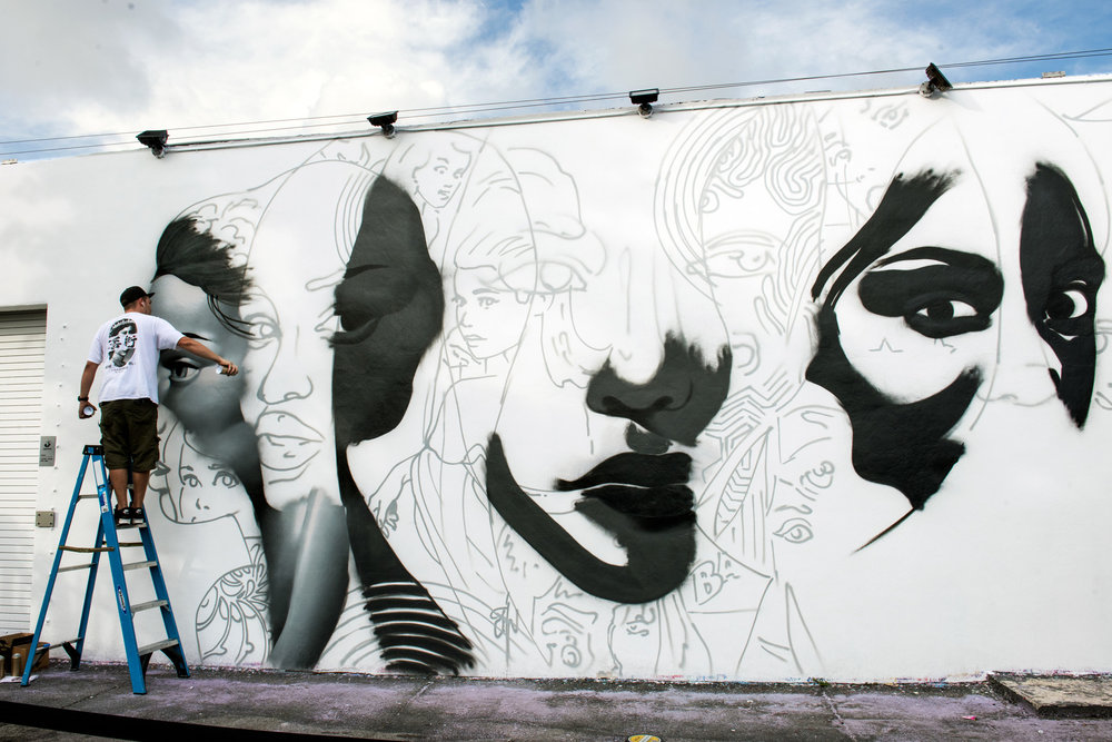 TRISTAN EATON IN PROGRESS ON HIS MURAL INSIDE THE WYNWOOD WALLS