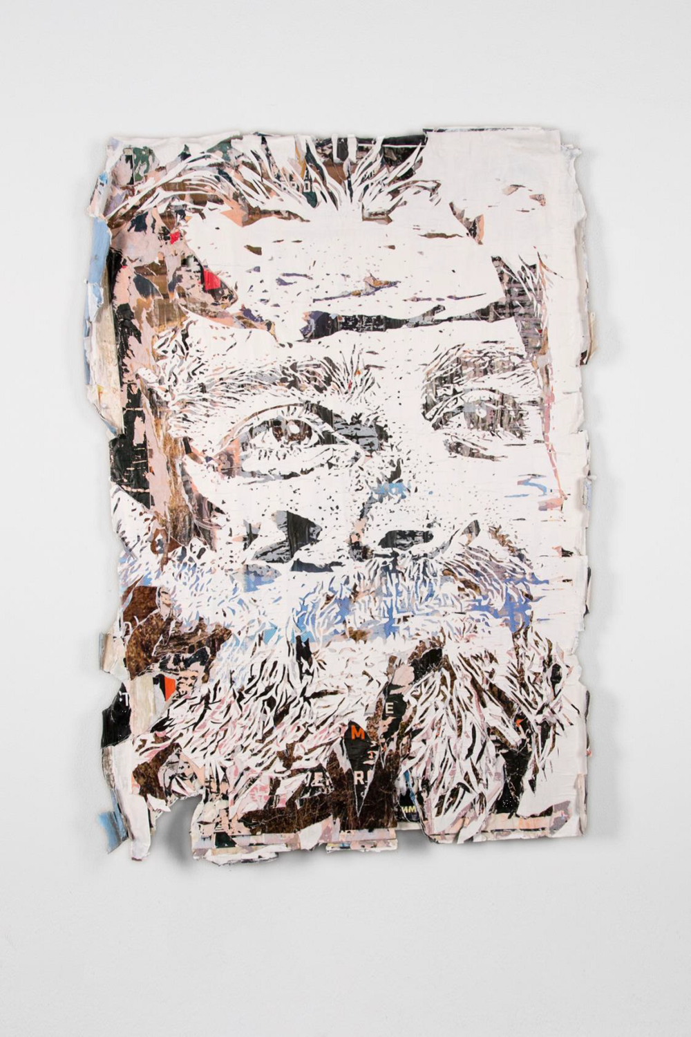 VHILS  Attrition #3, 2018   Advertising posters collected from the street, hand carved  73 x 51 in.