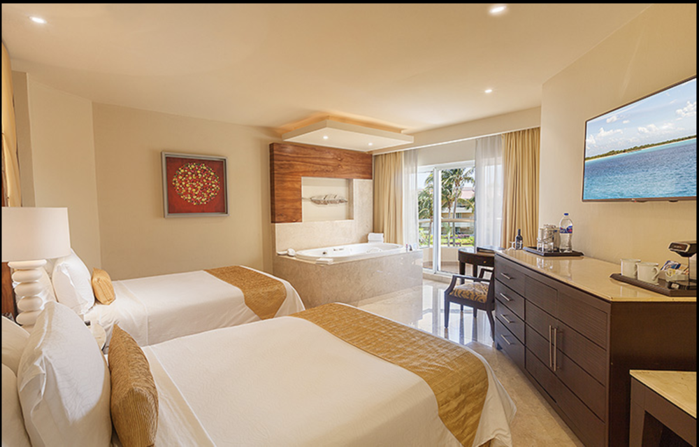 Grand Deluxe Garden View Room  Single Occupancy:  $483.74 USD per room, per night   Double Occupancy:  $519.44 USD per room, per night   Extra:  $212.42 USD per person per night   Child 17 and under:  FREE