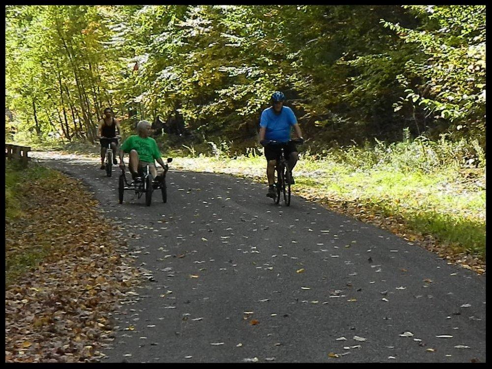 3 cyclist on trail.JPG