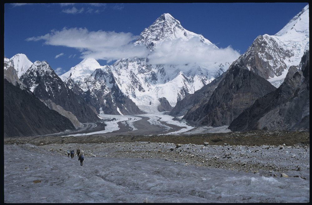 K2 and the Godwin-Austen Glacier from the Upper Baltoro Glacier en route to the Ali Camp. The south face of Broad Peak is on the right.