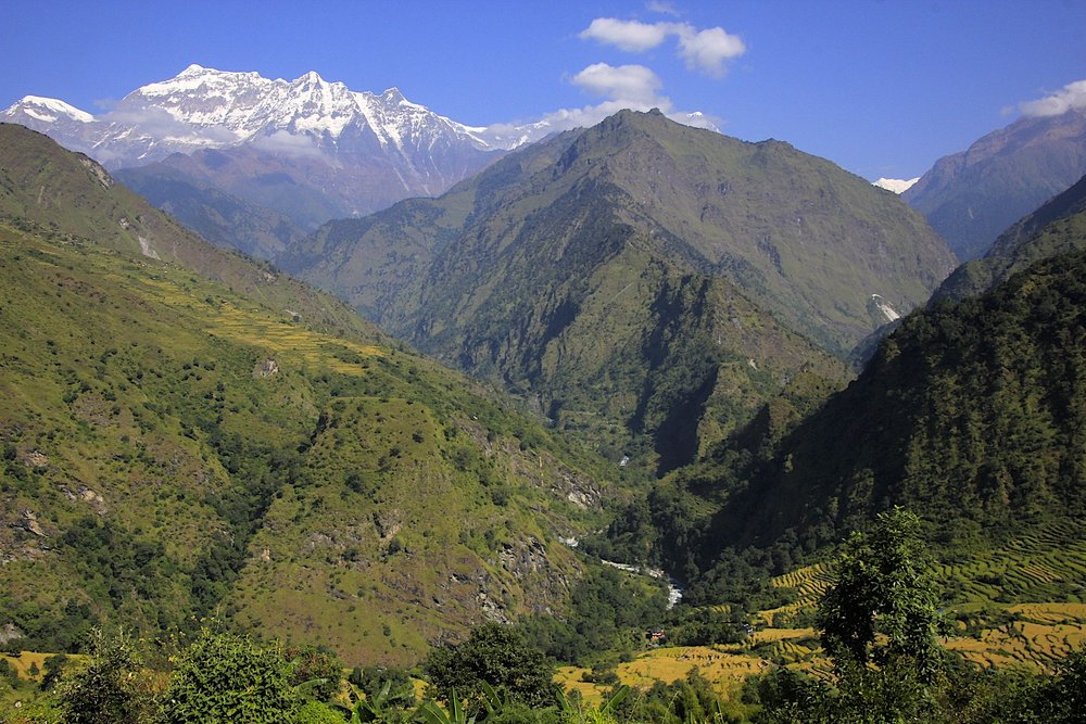 The Dhaulagiri range can be seen in the distance. The main mountain of the range, Dhaulagiri I, is on the right not visible in the photo. Our route was down from here and then into the valley on the right towards the barely visible white peak on the right.