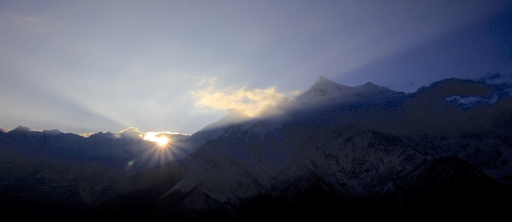 Sunrise behind Nilgiri Peak after the storm. We are looking at the Annapurna massif across the deepest valley in the world: Kali Gandaki. Imagine a valley with two 8,000m peaks on both sides (Annapurna I and Dhaulagiri)!