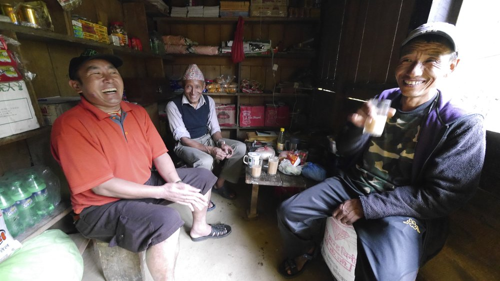 Having a good time in the teahouse. Sangey, the tea house owner and Kam. There were only 3 of us on this trip.