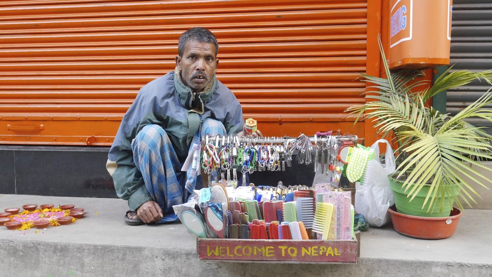 Every time I came to Kathmandu, this man sold me some small things. He was super nice. He died in 2015 and now his son sells the same trinkets from he same box in the same spot. Life is hard in Kathmandu.