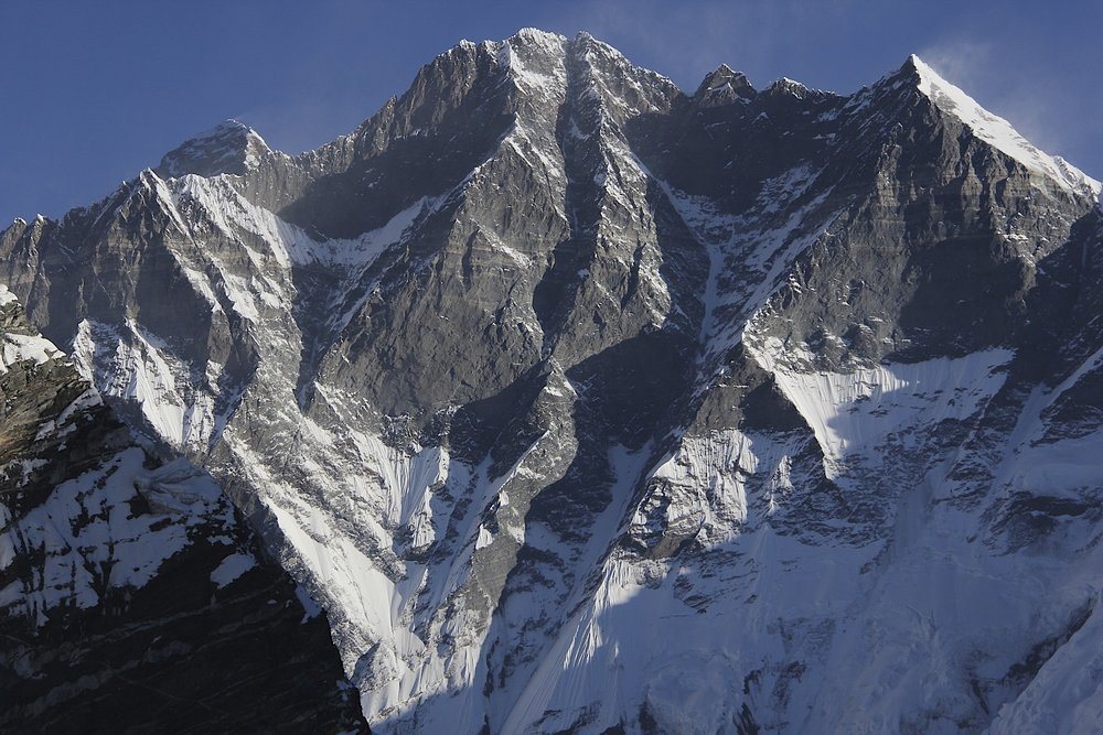 The south face of Lhotse with Mt. Everest peaking from behind the ridge.