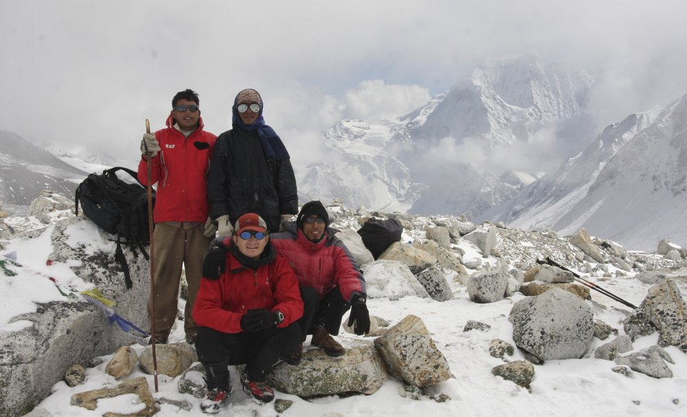 Larkya Pass: Kumar, Kam, me and Suri at 5,100m