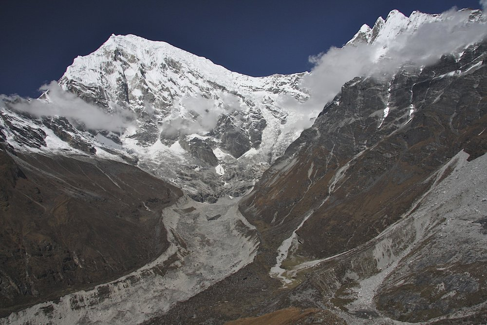 Langtang Lirung Glacier and basecamp. The tent of late Tomasz Humar is visible by the moraine in the centre. He died a few days after this photo was taken on the rocky slopes of Langtang Lirung above the BC on the ridge visible on the left side of the photo.