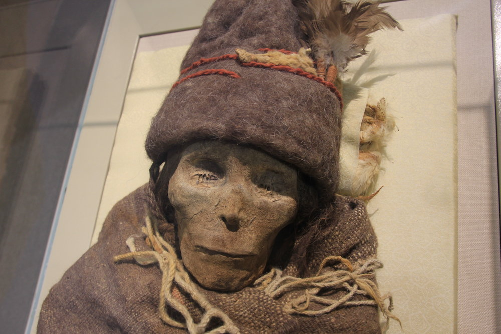 "The Tarim mummies are a series of mummies discovered in the Tarim Basin in present-day Xingjiang, China, which date from 1800 BC. 'The Beauty of Loulan"" - the oldest Tarim mummy."