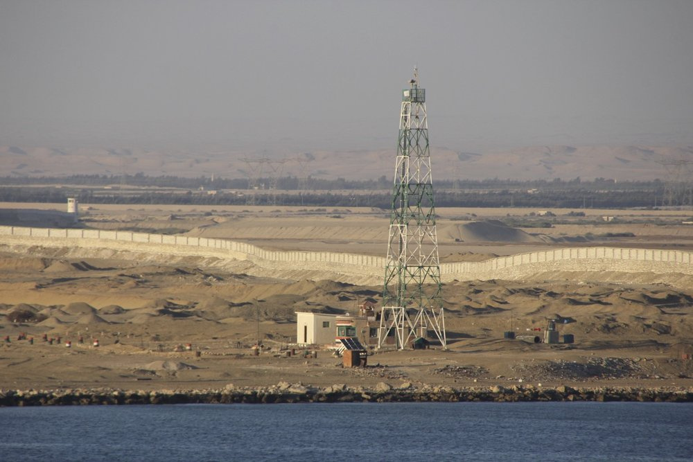 The wall lining the Suez Canal and the guard tower at the entrance