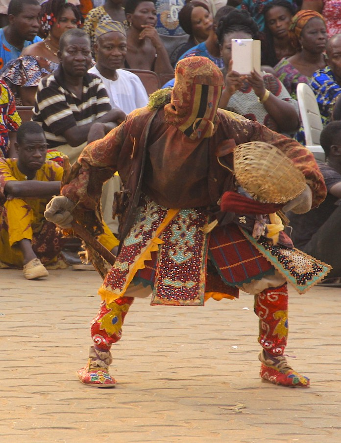Egungun is a dance performance that opens a portal between the realm of the dead and the living.  During the dance, the ancestors send blessings to the spectators and the entire community.